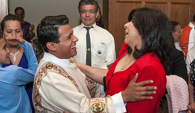 Reybert Pineda Avellaneda (left) hugs Pelar Castaneda (right) (check spelling-this came from  Avellaneda - said she was vocations office?). The Rite of Ordination to the order of Diaconite for Luis Efrain Alvarez Velazquez, Brian Baker, Desmond Drummer, Junot Nelvy and Reybert Pineda Avellaneda took place Saturday, May 25, 2013 at the Cathedral of Christ the King in Buckhead, Georgia. Archbishop Wilton Gregory, Bishop Luis Zamara and Bishop Talley were principal celebrants. (Photo by Thomas Spink for the Georgia Bulletin)