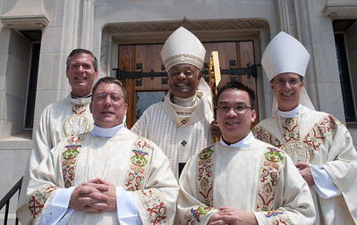 5-28-2011 - Atlanta, Georgia - Left to right, Vocations Director, Father Luke Ballman,  Deacon, Mark Richard Starr, Archbishop Wilton Gregory, Deacon, Tri John-Bosco Nguyen and Bishop Luis Zarama. The Rite of Ordination to the Order of Diaconate was celebrated at the Cathedral of Christ the King in Buckhead Saturday, May 28, 2011 for Mark Richard Starr and Tri John-Bosco Nguyen. Archbishop Wilton D. Gregory was the main celebrant and homilist. (Photo by Thomas Spink)
