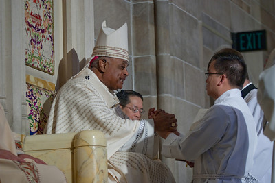 5-28-2011 - Atlanta, Georgia - Archbishop Gregory (left) and  Tri John-Bosco Nguyen (right) during the ordination Saturday. The Rite of Ordination to the Order of Diaconate was celebrated at the Cathedral of Christ the King in Buckhead Saturday, May 28, 2011 for Mark Richard Starr and Tri John-Bosco Nguyen. Archbishop Wilton D. Gregory was the main celebrant and homilist. (Photo by Thomas Spink)
