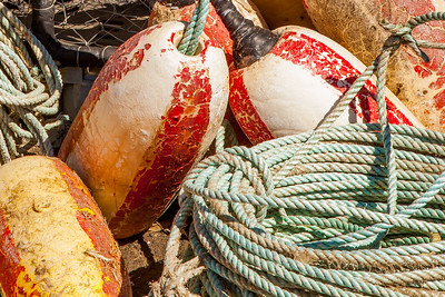 Newport harbor scene, coiled rope and  floats ready for crabbing season, Yaquina Bay, Oregon.