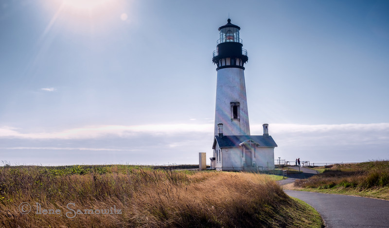 "8-18-13 Yaquina Head Lighthouse. -  I like the flare and the rainbow effect. What do you think?  Does the flare add or distract from the image?<br /> <br /> Thanks for all the feedback on my ""F"" Fog image."