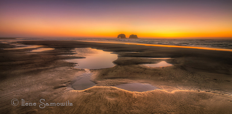 10-26-12 Rockaway Beach at a low tide sunset.  We have a place on the Oregon Coast in this town, in case you are wondering about why I have so many images of this location.  It is a magical place and my heart sings whenever I am there.  <br /> <br /> Critiques Welcome.