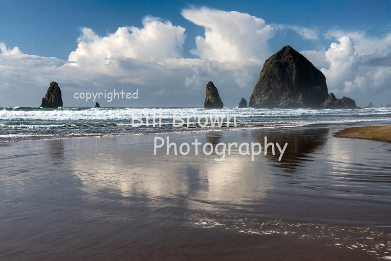 Haystack Rock and the Needles with Clouds and Reflections