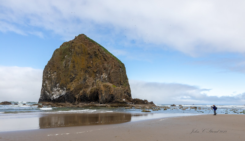 Haystack Rock ( 235 feet tall ) on Cannon Beach