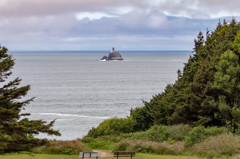 "Deactivated in 1957, Tillamook Lighthouse sits 1.2 miles offshore on 1 acre island. Nicknamed ""Terrible Tilly"". View from Ecola State Park."