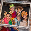 (Left to Right) Guests: Paula Little, Matt Little, Mark Gibson and Helen Tsau enjoy the photo booth at the 16th annual Zoolala benefit hosted by the Oregon Zoo Foundation.