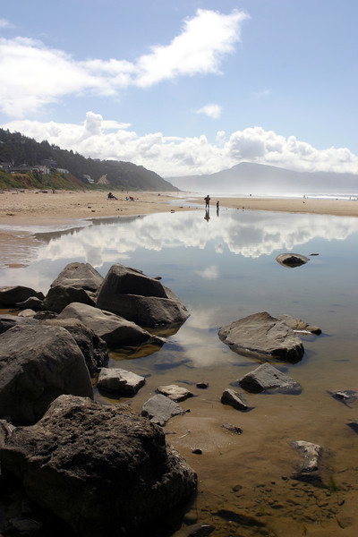 Low tide along the Oregon coast near Oceanside. We set up our blankets and spent the morning/afternoon lounging around the beach and cooling off in the ocean water. So few people for such a beautiful beach....Apparently that is the norm for the Oregon coastline.