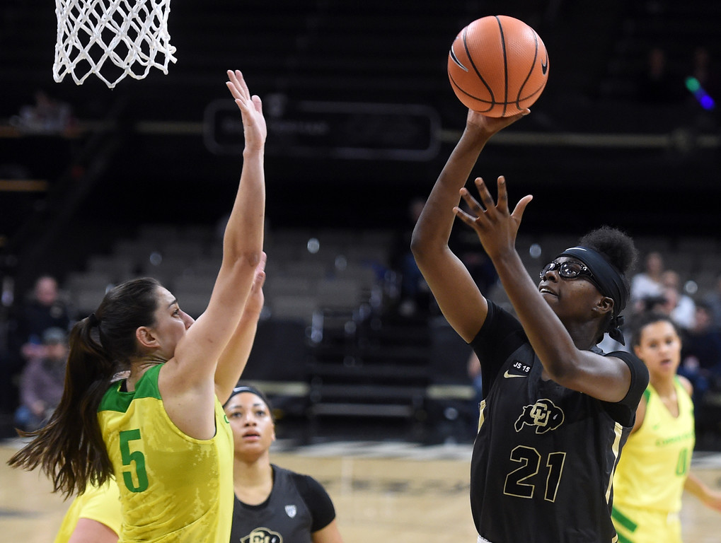 . Mya Hollingshed, of CU, shoots over Maite Cazorla, of Oregon. For more photos of the game, go to Buffzone.com.  Cliff Grassmick / Staff Photographer/ January 26, 2018
