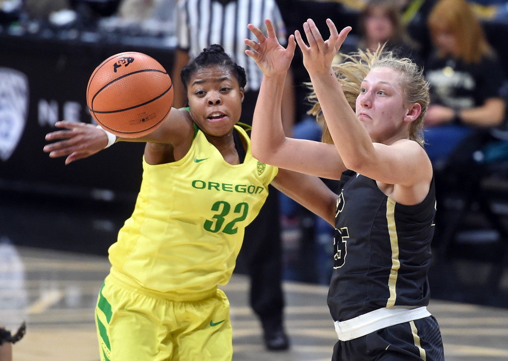 . Annika Jank, of CU, has the ball knocked away by Oti Gildon, of Oregon.For more photos of the game, go to Buffzone.com.  Cliff Grassmick / Staff Photographer/ January 26, 2018