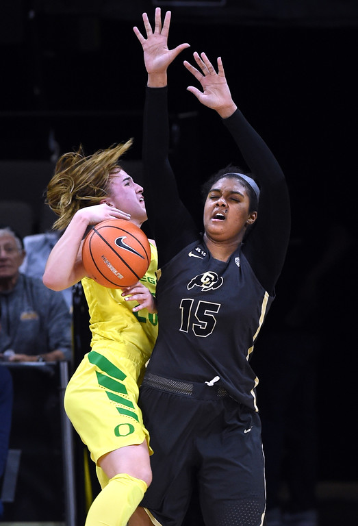 . Sabrina Ionescu, left, of Oregon, collides with Zoe Correal, of CU. For more photos of the game, go to Buffzone.com.  Cliff Grassmick / Staff Photographer/ January 26, 2018