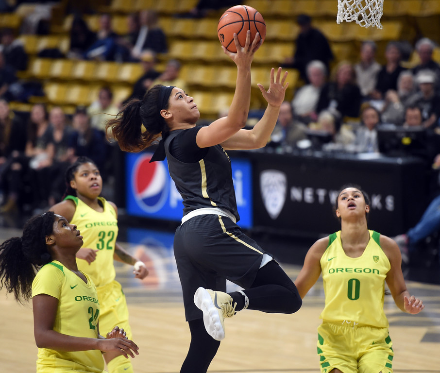 . Janea Bunn, of CU, drives on Satou Sabally and others, of Oregon.For more photos of the game, go to Buffzone.com.  Cliff Grassmick / Staff Photographer/ January 26, 2018