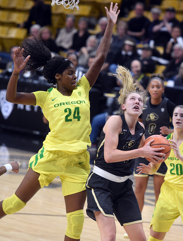 . Annika Jank, of CU, tries to score on Ruthy Hebard, of Oregon. For more photos of the game, go to Buffzone.com.  Cliff Grassmick / Staff Photographer/ January 26, 2018
