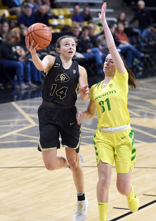 . Kennedy Leonard, of CU, drives on Aina Ayuso, of Oregon.For more photos of the game, go to Buffzone.com.  Cliff Grassmick / Staff Photographer/ January 26, 2018
