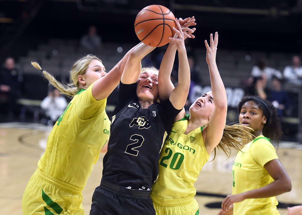 . Alexis Robinson, of CU, battles with Mallory McGwire, left, and Maite Cazorla, of Oregon. For more photos of the game, go to Buffzone.com.  Cliff Grassmick / Staff Photographer/ January 26, 2018