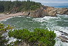 Scenic location at Shore Acres State Park with the waves of the Pacific Ocean crashing against the rocks.