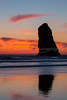 The Canon Beach haystacks at sunset on the Oregon coast, USA.