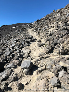 Climbing through the volcanic rock.