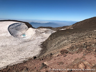 Teardrop Pool in the middle of the crater glacier.