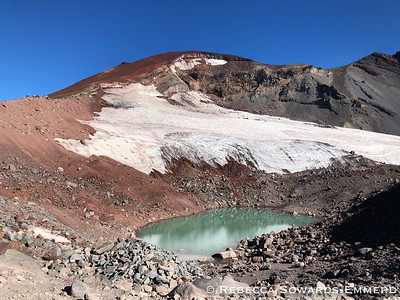 At approximately 8800 ft, about 1600 ft below the summit, the trail pops up to a small ridge with this gorgeous tarn. One of the only water sources on the trail.