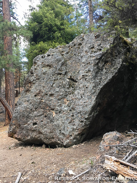 Several large boulders are strewn around the hillsides - some look like they are used for bouldering.
