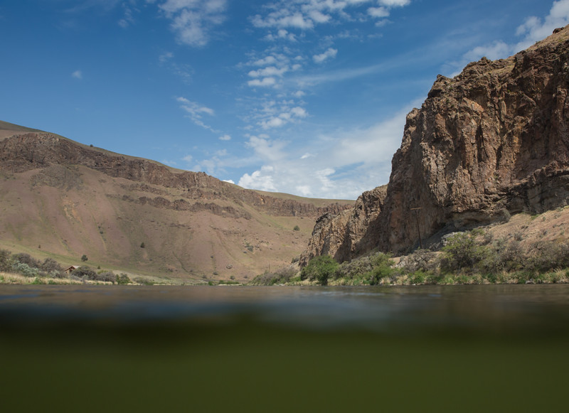 Tranquil Green Water Beneath Steep Canyon Walls