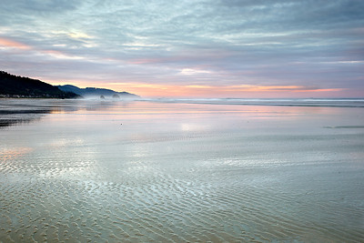 The sun rose to the left of the frame and lit up the clouds during a low tide.  This allowed the ripples of the last flows of water to be highlighted and the wide expanse of the beach to be felt.  This is an excellent walking beach at low tide!