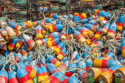 Crabbing floats are piled in front of the traps at the marina on Yaquina Bay in Newport, Oregon.