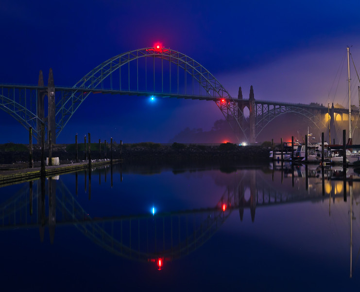 Foggy night in Newport harbor under the bridge