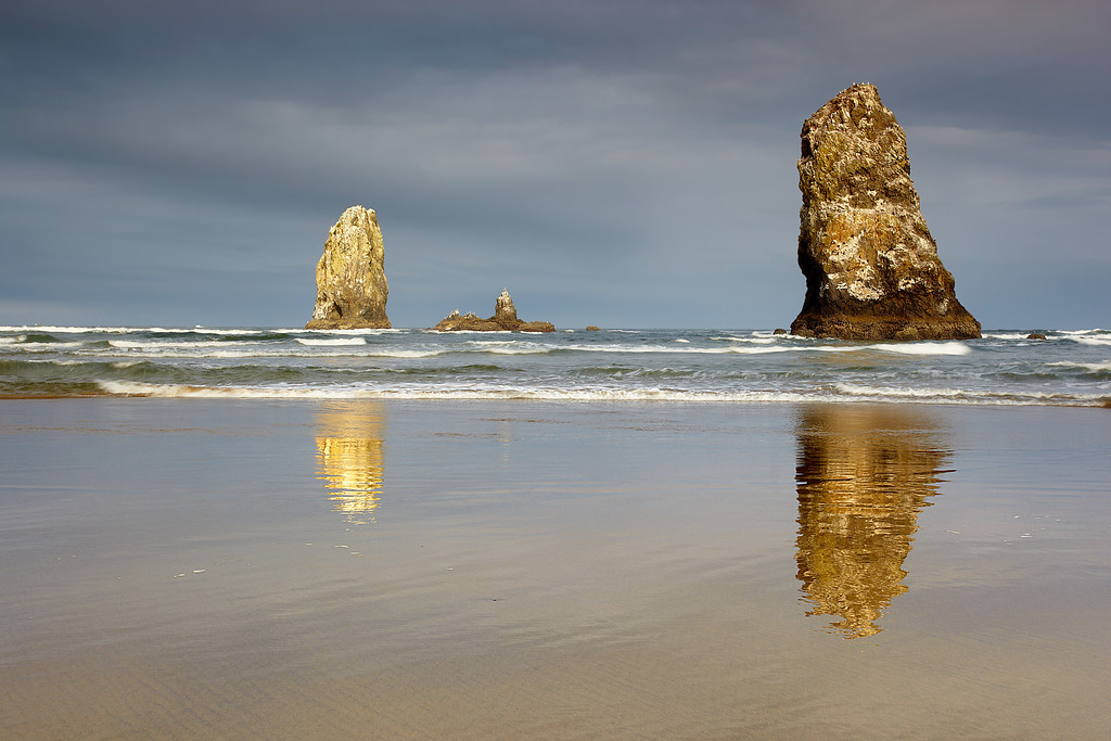 These are the needles that stand to the left of Haystack Rock on Cannon Beach in Northern Oregon.  They are actually quite large, as you can see by the very small dots that represent the nesting birds.  I made sure to get some good light and reflections into the frame before making this exposure.
