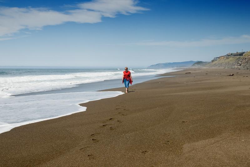 Eileen walking along the edge of the surf on a beautiful afternoon on the Oregon Coast.<br /> D200_2007-07-12DSC_1569-EileenWalkingSurf-2 copy.jpg