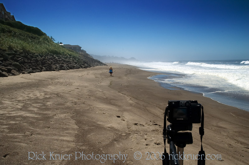 Eileen walking in the distance on the beach as Rick takes a photo of Rick taking video of Eileen walking along the beach. It was a very photographic trip, with Eileen taking pictures of Rick taking pictures and Rick taking photos of Eileen taking photos and Rick taking some video also. Eileen would walk for miles along the beach while Rick would stay close to home base, for safety of course. So we would know where home base is.<br /> <br /> ND70_2006-07-24DSC_5761-TakingVideoEileenWalkingSouth-2 copy.jpg