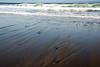 Ocean surf patterns in the sand<br /> Gleneden Beach, Oregon<br /> July 2007<br /> <br /> Copyright © 2007 Rick Kruer<br /> rickkruer.com<br /> <br /> D200_2007-07-12DSC_1513-SurfRocksPatterns-nice-2.psd