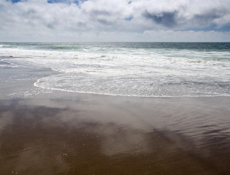 Surf reflections and shadows in the sand<br /> Gleneden Beach, Oregon<br /> July 2007<br /> <br /> Copyright © 2007 Rick Kruer<br /> rickkruer.com<br /> <br /> D200_2007-07-19DSC_2450-SurfShadowsWide-3.psd