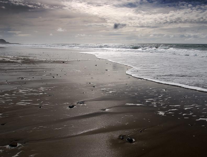 Oregon Coast Ocean Beach Patterns at the Cavalier Condo<br /> March 2009<br /> <br /> Copyright © 2009 Rick Kruer<br /> rickkruer.com<br /> <br /> D200_20090321_1551_DSC_1655-CavalierOceanBeachViewWetSand-nice-3.psd