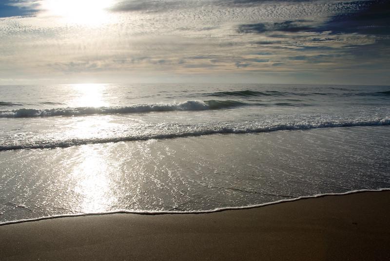 Low Tide Sunset<br /> Gleneden Beach, Oregon <br /> July 2007<br /> <br /> Copyright © 2007 Rick Kruer<br /> rickkruer.com<br /> <br /> D200_2007-07-15DSC_1956-OceanSunset-2.psd