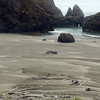 Haystack rocks on the beach at <br /> Gold Beach, Oregon<br /> July 2007<br /> <br /> Copyright © 2007 Rick Kruer<br /> rickkruer.com<br /> <br /> D200_2007-07-21DSC_2722-NiceBeachGoldBeachRocksTall-nice-2.psd