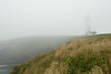 Yaquina Head Lighthouse, Newport, Oregon is barely visible in the fog.<br /> D200_2007-07-14DSC_1923-YaquinaHeadLighthouse-2.JPG