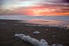 Winter Sunset on the Oregon Coast at the Cavalier Condo<br /> November 2008<br /> <br /> Copyright © 2008 Rick Kruer<br /> rickkruer.com<br /> <br /> D200_20081126_1751_DSC_8129-SunsetSeafoamBlowingWind-nice-2.psd