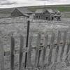 Abandoned Farm Behind Fence