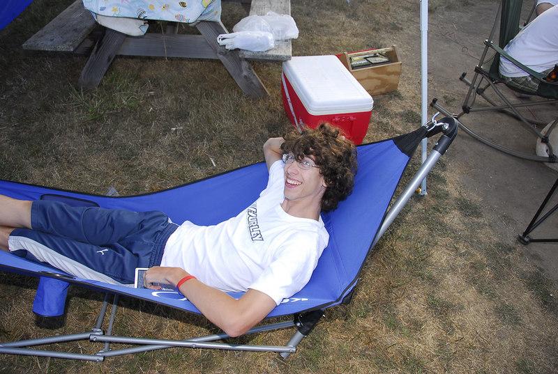 Trey holds down the hammock in between video games.