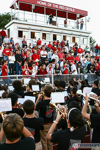 Director Matthew Kurinsky looks on as his students in the Hinsdale Central High School Marching Band performs the national anthem for fans at the Hinsdale Central stadium just before the Red Devils kick off against the Morton High School Potters.