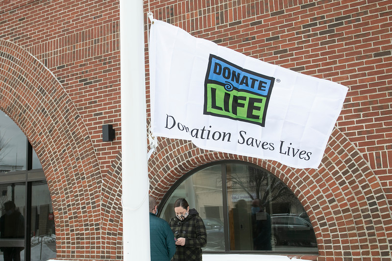 """The City of Fitchburg celebrated Valentine's week by joining an organ donor recipient and others touched by organ donation to celebrate national Organ Donor Day and ask people to """"Have a Heart and get a Heart"""" by registering as a donor at the RMV when getting or renewing your driver's license, Real ID, or ID.  A donor flag was raised on Main Street at the press conference. SENTINEL & ENTERPRISE/JOHN LOVE"""