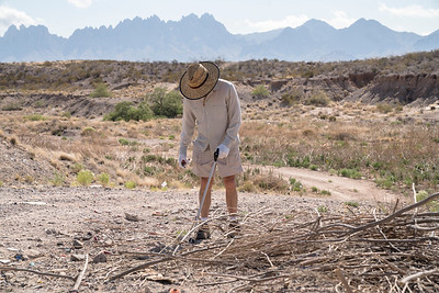 Bob Tafanelli, with the Friends of the Organ Mountains-Desert Peaks, cleans up trash outside of Las Cruces, New Mexico.