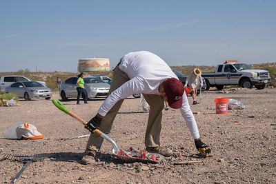 Gabe Vasquez, with the Friends of the Organ Mountains-Desert Peaks, cleans up trash outside of Las Cruces, New Mexico.
