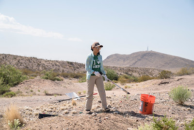 Brenda Gallegos, with the Friends of the Organ Mountains-Desert Peaks, cleans up trash at an illegal dumpsite outside of Las Cruces, New Mexico.