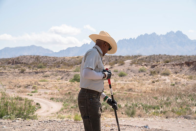 Rico Smith, with the Bureau of Land Management, cleans up an illegal dumpsite outside of Las Cruces, New Mexico.
