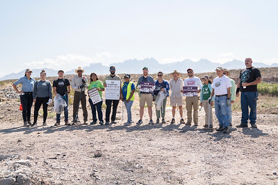 Participants of the of the Friends of the Organ Mountains-Desert Peaks site clean up pose for a photo.