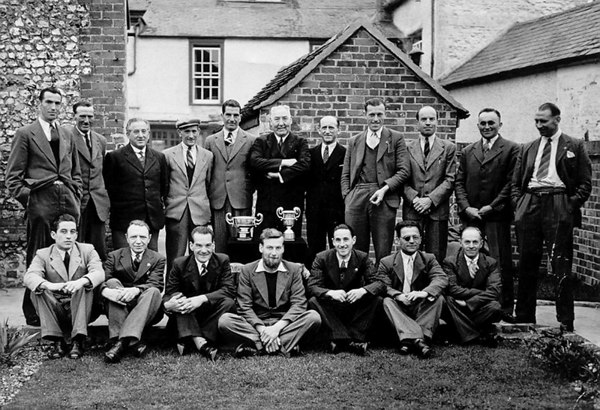 <font size=3><u> - The Sun Public House Darts team - </u></font> (BS0256)  Back row l-to-r:  Burn Harbour, Mr Douglas, Mr Collett, Mr Vocking, Mr Frankham, Fred Young, ??,  Mr Brannigan, Lionel Harvey, Freddie Parks, Scratchy Field.  Front row l-to-r:  Dennis Haines, Mr Townsend, Arthur Butcher, Mr Attwood, Bill Stroud, Bert Field, Tooter Cook.