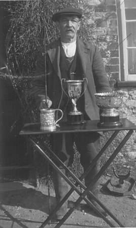 "<font size=3><u> - Fisherman with Trophy - 1936 - </u></font> (BS0261)  ""Joey"" Lane.Several times winner Angling club prize giving."