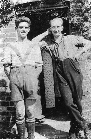 <font size=3><u> - Footballer and Friend - 1928 - </u></font> (BS0234)  Walter Field on the left. Right is Bill Lane.  Outside Mrs. Lane's back door, Birmingham Yard.
